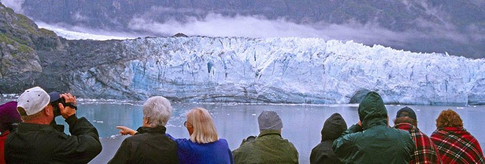 Glacier Bay, Alaska, cruise ship passengers observing John Hopkin Glacier